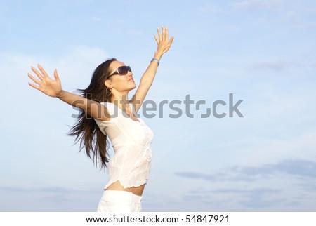 Beautiful brunette over sky background - stock photo