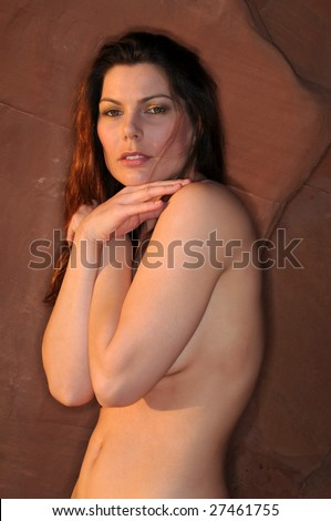 Beautiful brunette posing nude against red rocks near Las Vegas, Nevada