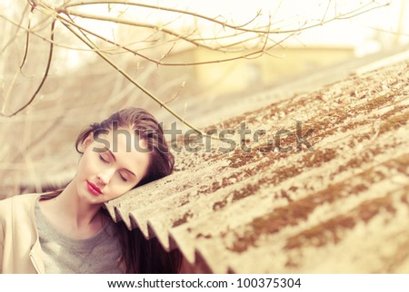 beautiful brunette posing on a sunny day - stock photo