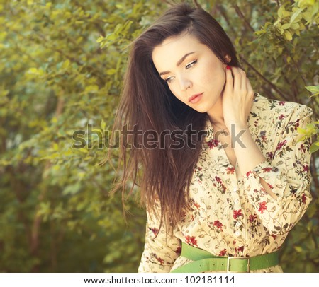 beautiful brunette posing outdoors - stock photo