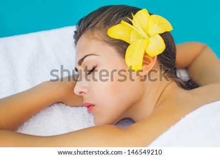 Beautiful brunette relaxing at spa treatment - stock photo