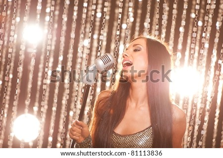Beautiful brunette singing - stock photo