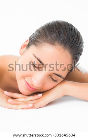 Beautiful brunette sleeping after a salt scrub treatment