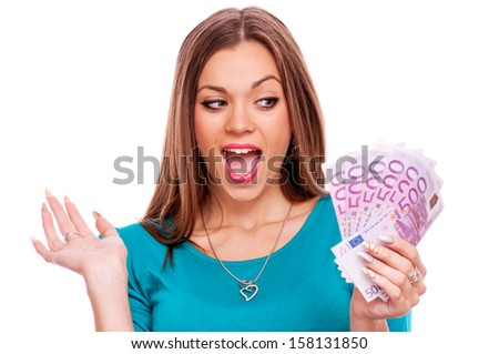 Beautiful brunette surprised facial expression holding five-hundred Euro bills, isolated on white - stock photo