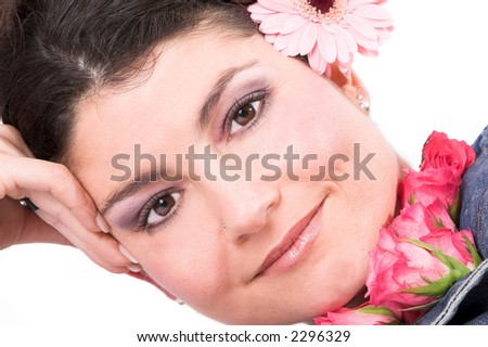 Beautiful brunette surrounded by pink flowers - stock photo