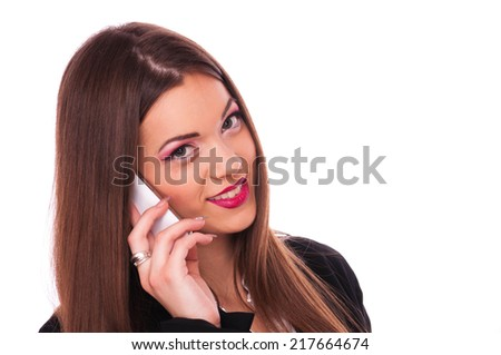 Beautiful brunette talking on mobile phone, isolated on white - stock photo