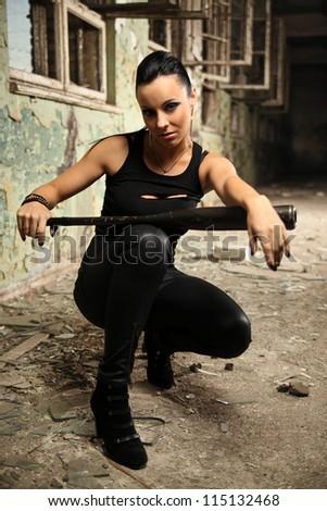 beautiful brunette with baseball bat - stock photo