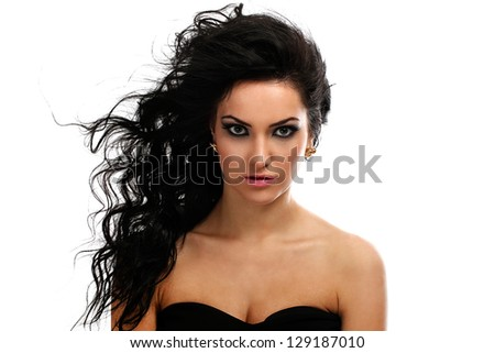Beautiful brunette with curls evening makeup isolated over white background