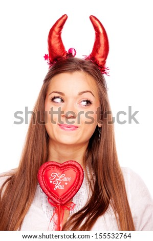 Beautiful brunette with heart and red devil horns, isolated on white - stock photo
