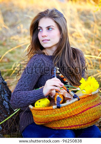 Beautiful brunette with long hair spending a day outdoor in the countryside. - stock photo