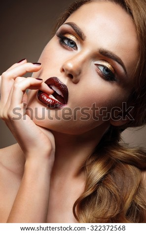 Beautiful brunette with red lips. - stock photo