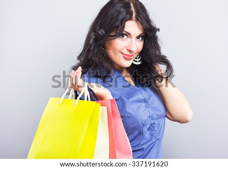 Beautiful brunette with Shopping bags.Portrait of a young woman with new purchases