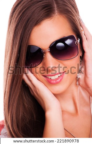 Beautiful brunette with sunglasses - stock photo