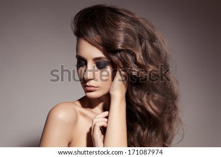 Beautiful Brunette Woman. Curly Long Hair.  - stock photo