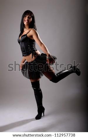 beautiful brunette woman dressed in modern ballerina style - stock photo