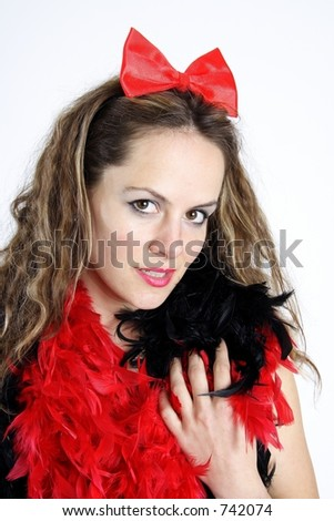 Beautiful brunette woman dressed with black underwear and a red feather boa an bow tie