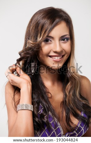beautiful brunette woman face with brown eyes - stock photo