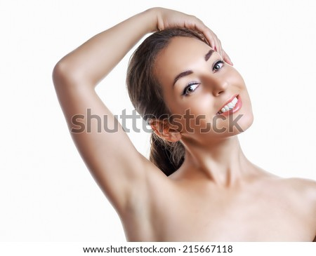 beautiful brunette woman holding her arms up and showing underarms, isolated on white studio background - stock photo