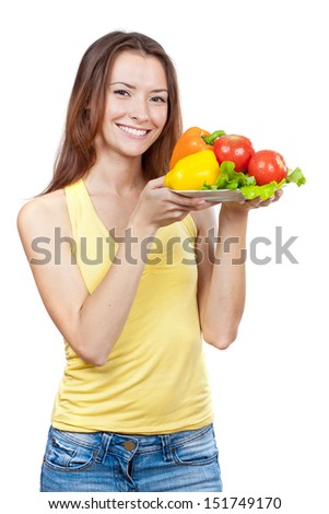 Beautiful brunette woman holding plate of fresh vegetables