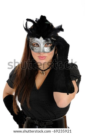 Beautiful brunette woman in black dress in party carnival mask . isolated on white background