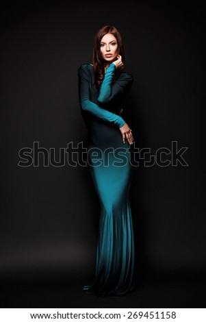 Beautiful brunette woman in long evening dress - stock photo