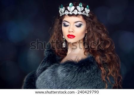 Beautiful brunette woman in mink fur coat. Jewelry. Fashion Beauty girl model with long healthy wavy hair styling. - stock photo
