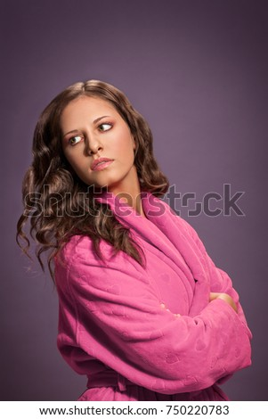 Beautiful brunette woman in pink bathrobe