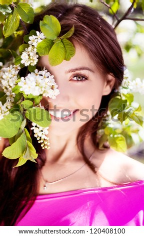 beautiful brunette woman in the park on a warm summer day - stock photo