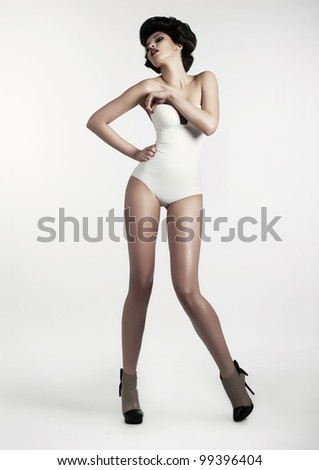 Beautiful Brunette Woman in White Vintage Clothing posing - Pin up Style - stock photo