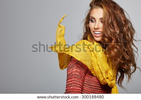 Beautiful brunette woman portrait  in autumn color. Studio shoot - stock photo