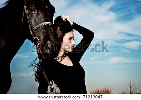 beautiful brunette woman portrait with horse, late summer day