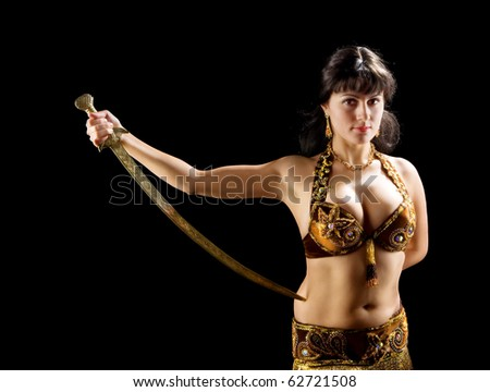 beautiful  brunette woman stand with sword