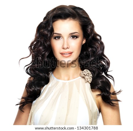 Beautiful brunette woman with beauty long curly hairstyle. Fashion model with wavy hairs
