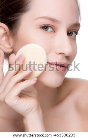 Beautiful brunette woman with clean perfect fresh skin using cotton pad skin care concept. Isolated on a white.