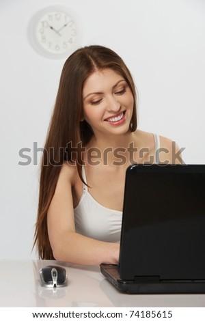 Beautiful brunette woman with laptop - stock photo