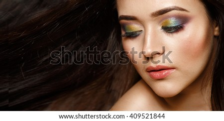 Beautiful brunette woman with long hair. - stock photo