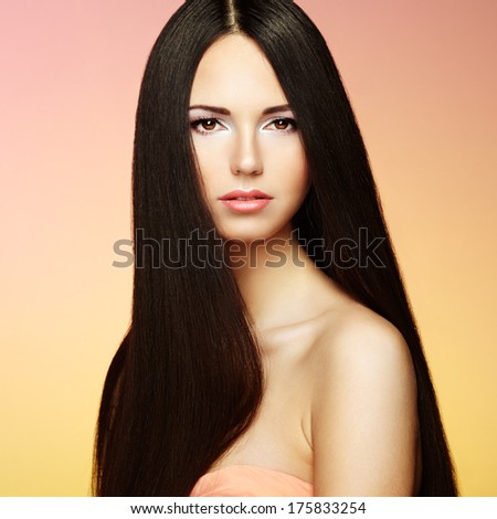 Beautiful brunette woman with long hair. Beauty photo - stock photo