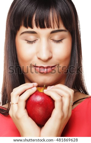 beautiful brunette woman with red apple in hands