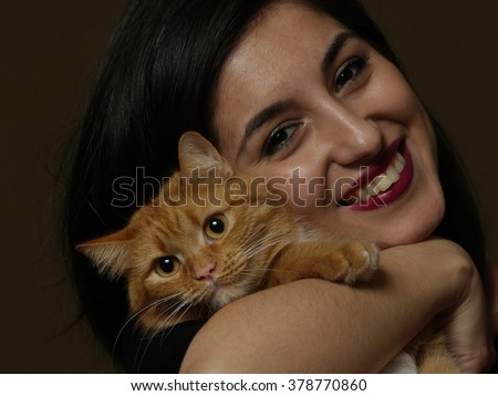 beautiful brunette woman with red cat - stock photo