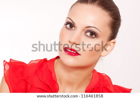 beautiful brunette woman with red lips and red shirt - stock photo