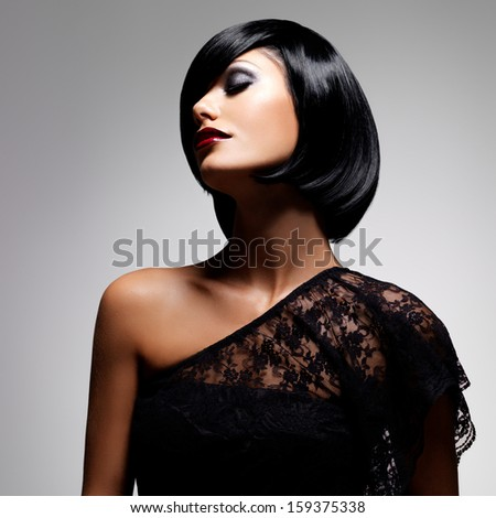 Beautiful brunette woman with shot hairstyle, closeup portrait of a female model - stock photo