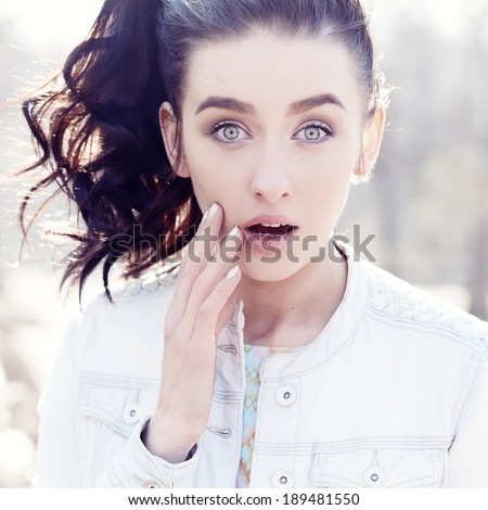 Beautiful brunette young woman eyes - stock photo
