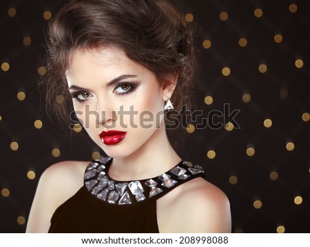 Beautiful brunette young woman. Fashion girl model over bokeh lights background - stock photo