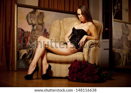 Beautiful brunette young woman sitting on the chair