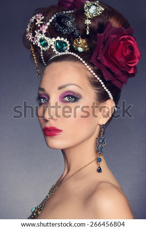 beautiful brunette young woman with accessories.fashionable lady.jewelery queen. Crown hair - stock photo