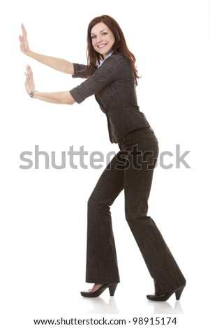 beautiful brunettepushing and object on white background