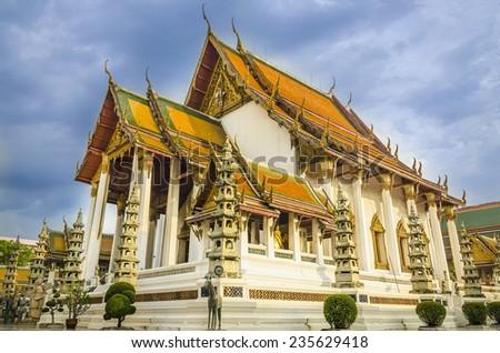 Beautiful buddhist temple on a background of blue sky, Bangkok, Thailand - stock photo
