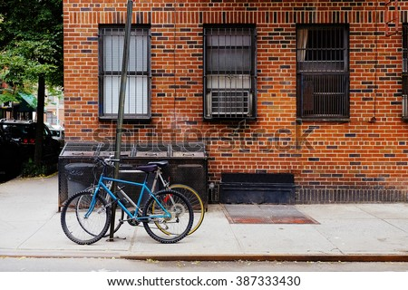 Beautiful building. Entrance door and bicycle, Manhattan New York. Classic apartment building in New York City. - stock photo
