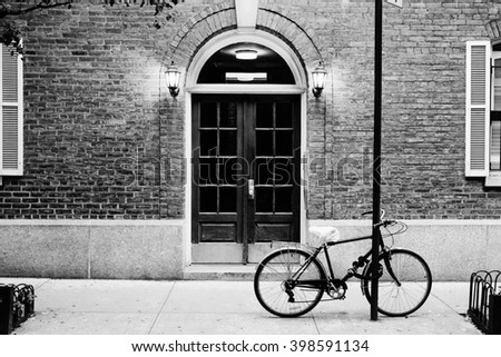 City Apartment Building Entrance beautiful building entrance door bicycle manhattan stock photo