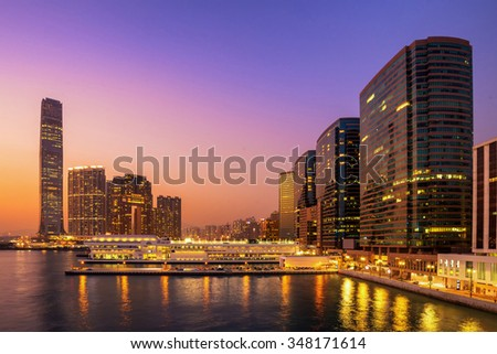 Beautiful Building in Hong Kong at night and Victoria Harbor view - stock photo
